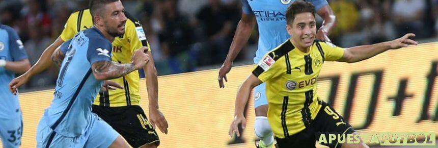 Jugadores de Borussia Dortmund y Manchester City en un partido de Champions League